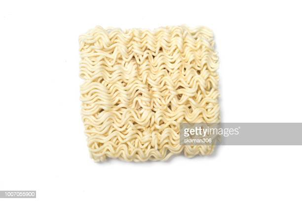 dry noodle on white background - ramen noodles stock pictures, royalty-free photos & images