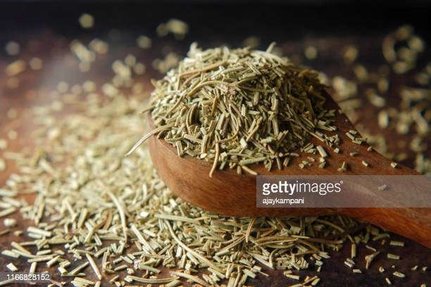 dry rosemary spice on dark. macro with shallow depth of field. - rosemary stock pictures, royalty-free photos & images