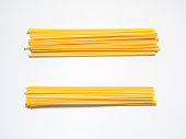 Dry spaghetti on a white background for the menu. Geometric background. Flat lay, copy space, top view