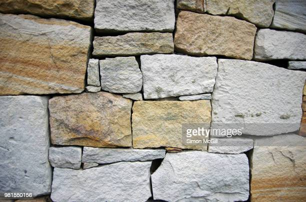 dry stone retaining wall - stone wall stock pictures, royalty-free photos & images