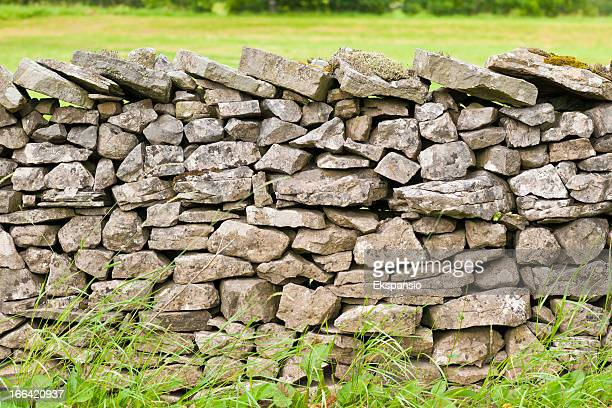 dry stone wall with lichen and moss - stone wall stock pictures, royalty-free photos & images