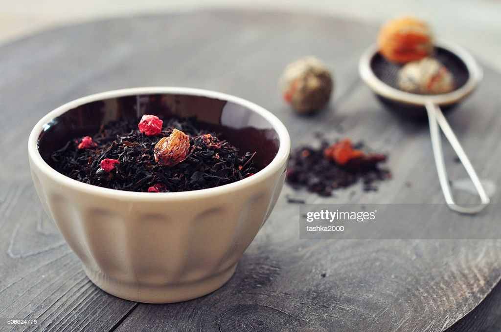 Dry tea with dried berries : Stock Photo