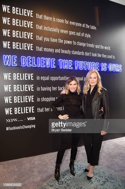 DryBar Founder Alli Webb and SVP North America Marketing for Visa Mary Ann Reilly pose in front of the Visa NYFW Fashion Manifesto Wall during New...
