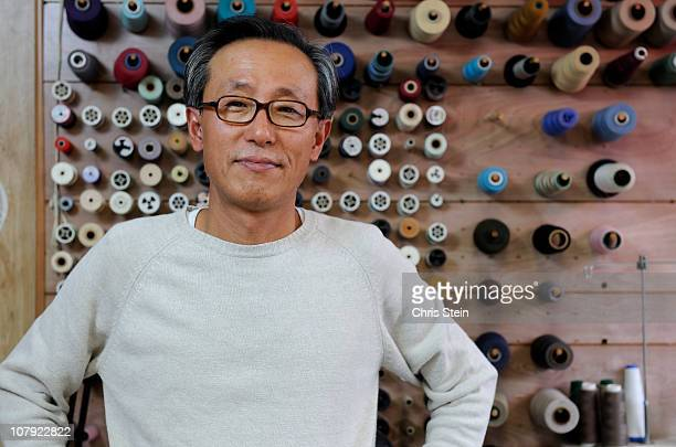 drycleaner  owner in his store - korean ethnicity stock pictures, royalty-free photos & images