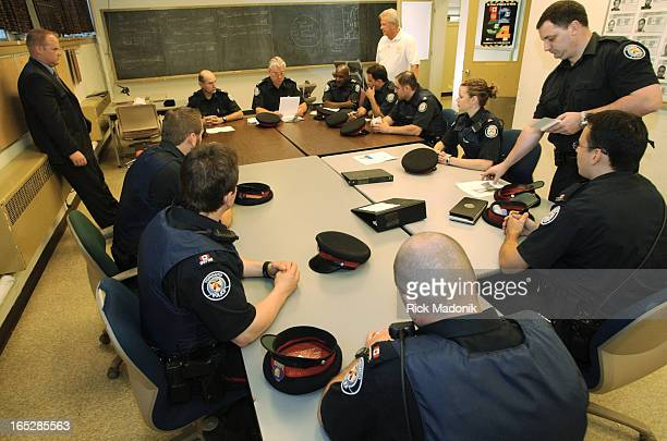dryden 05/17/04 TORONTO ONTARIO The final roll call at 51 division on Regent Street was held today Tomorrow the division relocates to it's new...