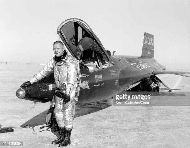Dryden pilot Neil Armstrong poses next to the X-15 ship 1 rocket-powered aircraft after a research flight, November 30, 1959. Image courtesy National...