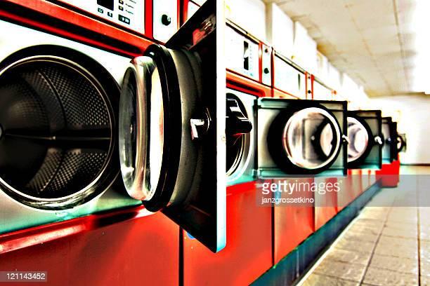 dryers in laundromat - waschsalon stock-fotos und bilder