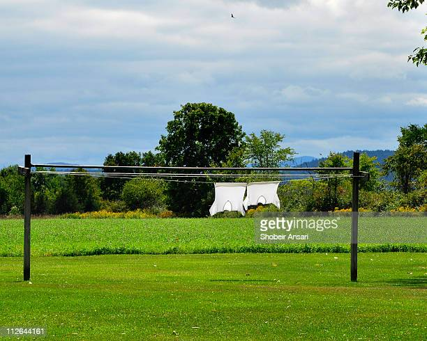 drying clothes - clothesline stock pictures, royalty-free photos & images