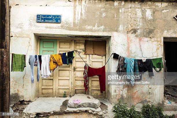 drying clothes - slum stock pictures, royalty-free photos & images