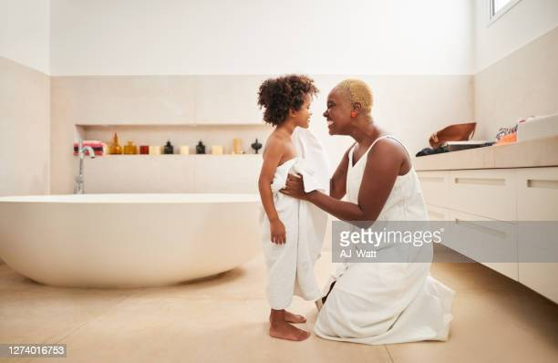 drying off her son after bath - wrapped in a towel stock pictures, royalty-free photos & images