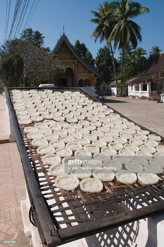 Drying rice cakes for monks, Luang Prabang, Laos, Indochina, Southeast Asia, Asia : Stock Photo
