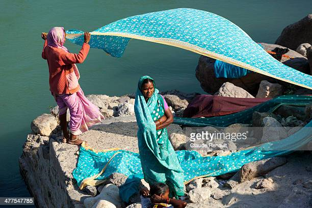 Drying saris on the banks of the Ganges in Rishikesh. Uttarakhand.