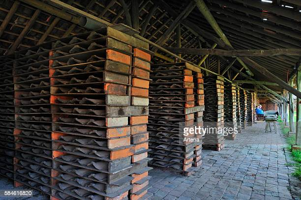 Drying yard with roof tiles in racks at brickworks Boom Belgium