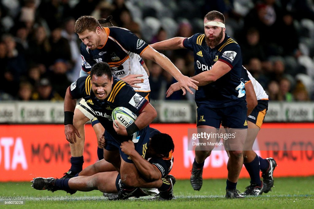 dSiate Tokolahi of the Highlanders is tackled during the round nine Super Rugby match between the Highlanders and the Brumbies at Forsyth Barr Stadium on April 14, 2018 in Dunedin, New Zealand.