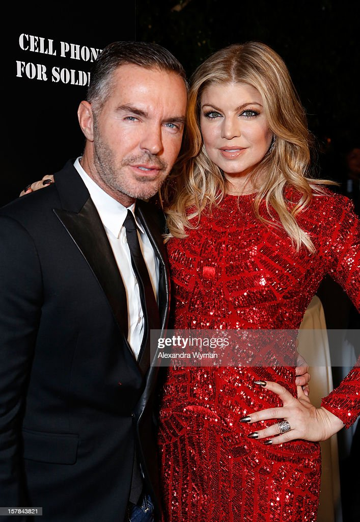 Dsquared Founder Dan Caten and Host Fergie attend Voli Light Vodka's Holiday Party hosted by Fergie Benefiting Cellphones for Soldiers at SkyBar at the Mondrian Los Angeles on December 6, 2012 in West Hollywood, California.