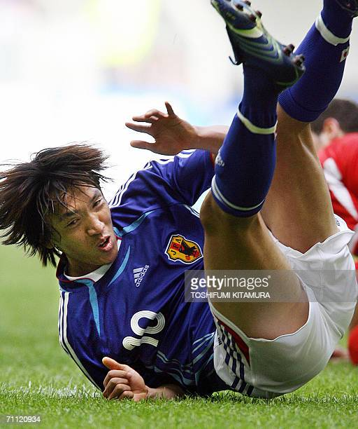 Japanese midfielder Shunsuke Nakamura fall on the ground during the second half of their friendly match against Malta at the LTU Arena in Dusseldorf...