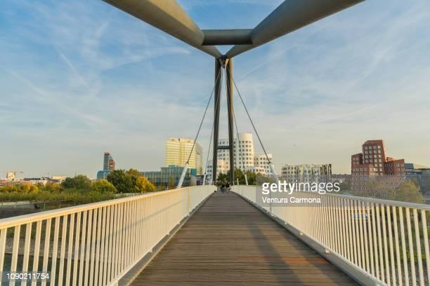 düsseldorf harbor bridge, germany - 歩道橋 ストックフォトと画像