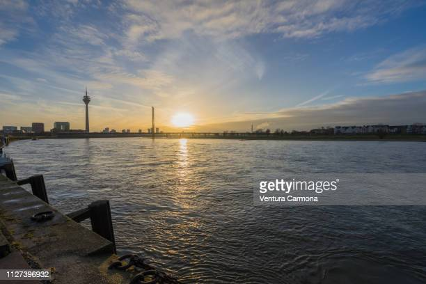 düsseldorf rhine panorama at sunset - spiegelung stock pictures, royalty-free photos & images