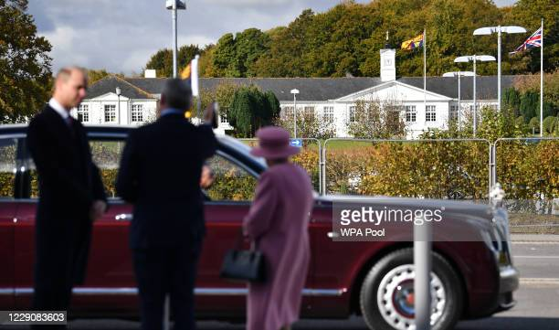 Dstl Chief Executive Gary Aitkenhead shows Britain's Queen Elizabeth II and Prince William Duke of Cambridge the Royal Standard flying over their...