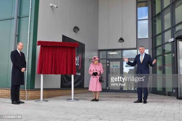 Dstl Chief Executive Gary Aitkenhead speaks as Britain's Queen Elizabeth II and Prince William Duke of Cambridge prepare to unveil a plaque to...