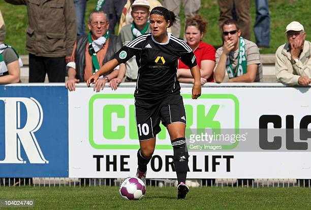 Dszenifer Marozsan of Frankfurt runs with the ball during the Women's bundesliga match between FCR Duisburg and FFC Frankfurt at the PCCStadium on...