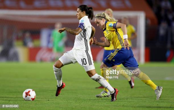 Dszenifer Marozsan of Germany and Lisa Dahlkvist of Sweden compete for the ball during the Group B match between Germany and Sweden during the UEFA...