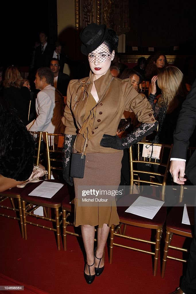 Dta von Teese attends the John Galliano Ready to Wear Spring/Summer 2011 show during Paris Fashion Week at Opera Comique on October 3, 2010 in Paris, France.
