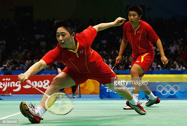 Du Jing and Yu Yang of China in action against Lee Hyojung and Lee Kyungwon of South Korea during the Women's Doubles Final at the Beijing University...