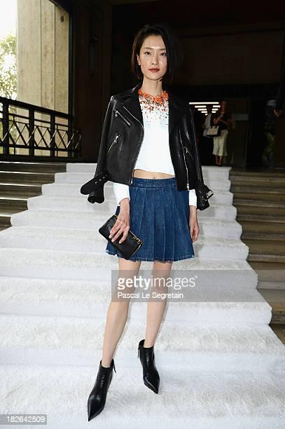 Du Juan attends the Miu Miu show as part of the Paris Fashion Week Womenswear Spring/Summer 2014 at Palais d'Iena on October 2 2013 in Paris France