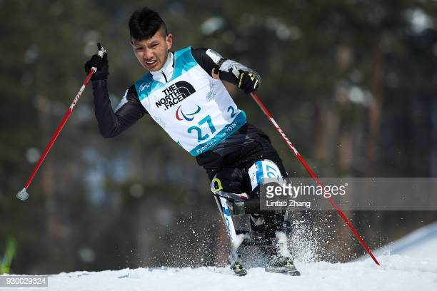 Du Mingyuan of China competes in the Men's 75 KM Sitting Biathlon event at Alpensia Biathlon Centre during day one of the PyeongChang 2018 Paralympic...