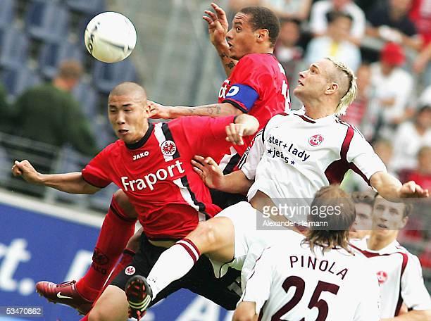 Du Ri Cha and Jermaine Jones of Frankfurt compete with Jan Polak of Nuernberg during the Bundesliga match between Eintracht Frankfurt and 1FC...