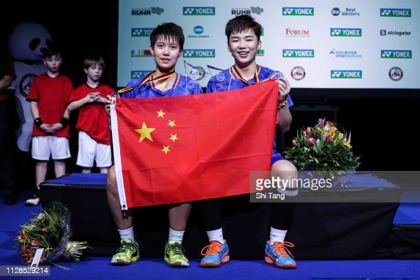 Du Yue and Li Yinhui of China pose with their medals after the Women's Double final match against Misaki Matsutomo and Ayaka Takahashi of Japan...