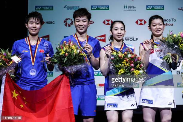 Du Yue Li Yinhui of China and Misaki Matsutomo Ayaka Takahashi of Japan pose with their medals after the Women's Double final match during day six of...