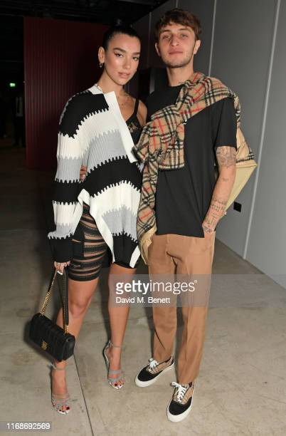 Dua Lipa and Anwar Hadid attend the Burberry September 2019 show during London Fashion Week on September 16 2019 in London England