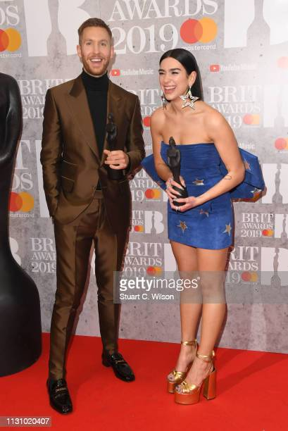 Dua Lipa and Calvin Harris in the winners room during The BRIT Awards 2019 held at The O2 Arena on February 20, 2019 in London, England.