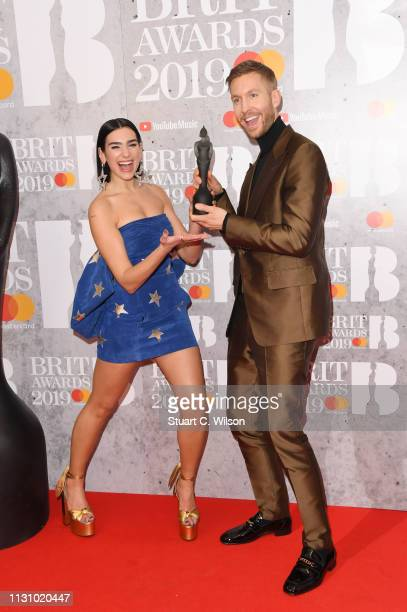 Dua Lipa and Calvin Harris in the winners room during The BRIT Awards 2019 held at The O2 Arena on February 20 2019 in London England