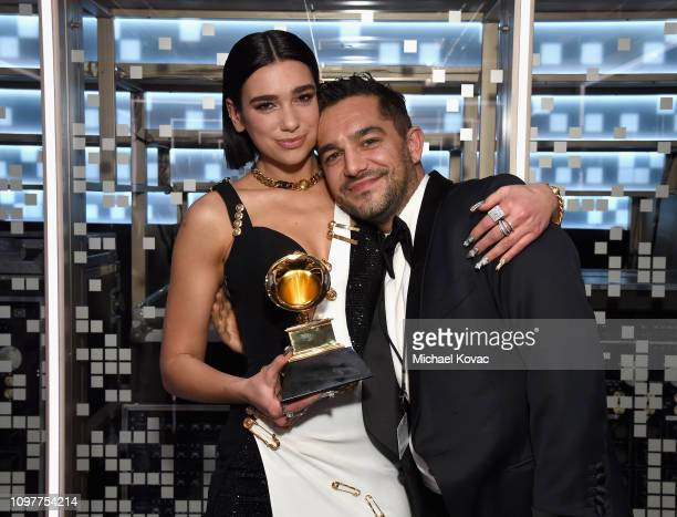 Dua Lipa and talent manager Ben Mawson backstage during the 61st Annual GRAMMY Awards at Staples Center on February 10 2019 in Los Angeles California