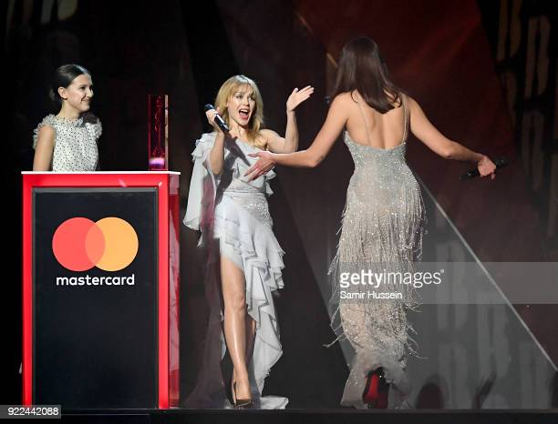 AWARDS 2018 *** Dua Lipa collects the award for British Female Solo Artist presented by Kylie Minogue and Millie Bobby Brown on stage at The BRIT...