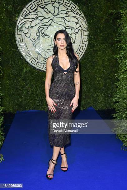 Dua Lipa is seen on the front row of the Versace special event during the Milan Fashion Week - Spring / Summer 2022 on September 26, 2021 in Milan,...