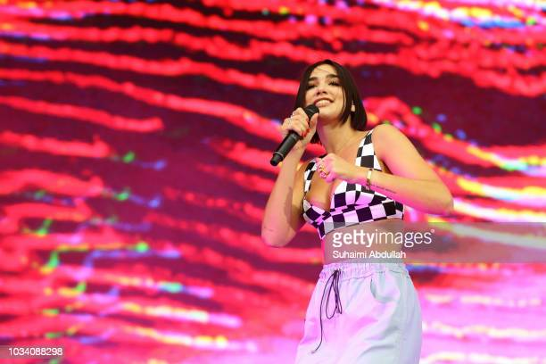 Dua Lipa performs on stage during day three of the 2018 Singapore Formula One Grand Prix at Marina Bay Street Circuit on September 16, 2018 in...