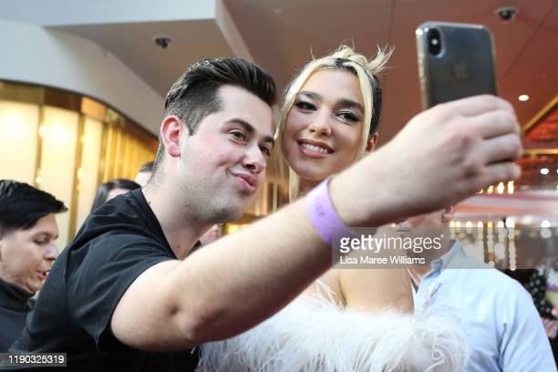 Dua Lipa poses with fans on the red carpet ahead of the 33rd Annual ARIA Awards 2019 at The Star on November 27 2019 in Sydney Australia