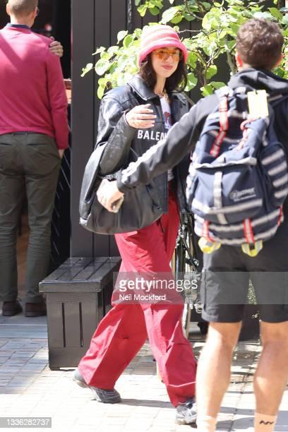 Dua Lipa seen leaving a hotel on August 25, 2021 in London, England.
