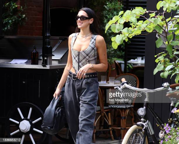 Dua Lipa seen leaving her hotel and heading to a studio on August 27, 2021 in London, England.