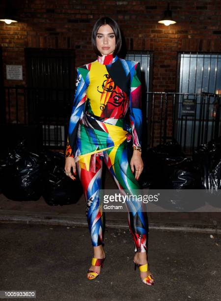 Dua Lipa wears the same Versace bodysuit that Gigi Hadid wore at the 2018 CFDA awards when out and about for dinner on July 27 2018 in New York City