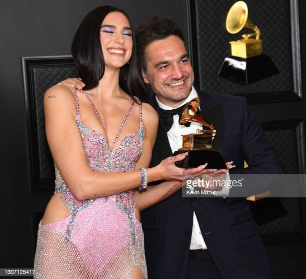 Dua Lipa, winner of Best Pop Vocal Album for 'Future Nostalgia', and Ben Mawson pose in the media room during the 63rd Annual GRAMMY Awards at Los...