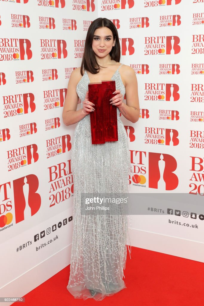 Dua Lipa, winner of the British Female Solo Artist and British Breakthrough act awards, poses in the winners room during The BRIT Awards 2018 held at The O2 Arena on February 21, 2018 in London, England.