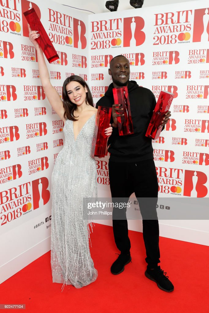 Dua Lipa, winner of the British Female Solo Artist and British Breakthrough act awards and Stormzy, winner of the British Album of the Year and British Male Solo Artist awards, pose in the winners room during The BRIT Awards 2018 held at The O2 Arena on February 21, 2018 in London, England.