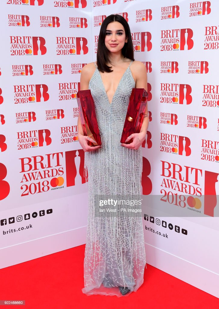 Dua Lipa with her awards for Best British Female Solo Artist and Breakthrough Act in the press room during the Brit Awards at the O2 Arena, London.