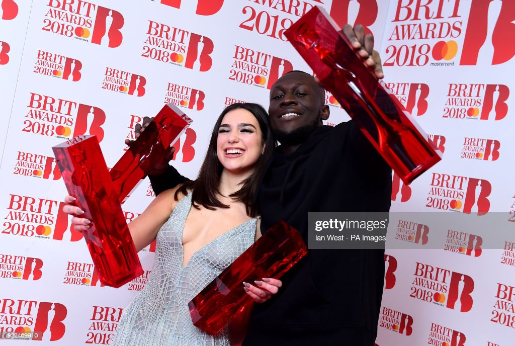 Dua Lipa with her awards for Best British Female Solo Artist and Breakthrough Act and Stormzy with his British Album of the Year and British Male Solo Artist awards in the press room during the Brit Awards at the O2 Arena, London.