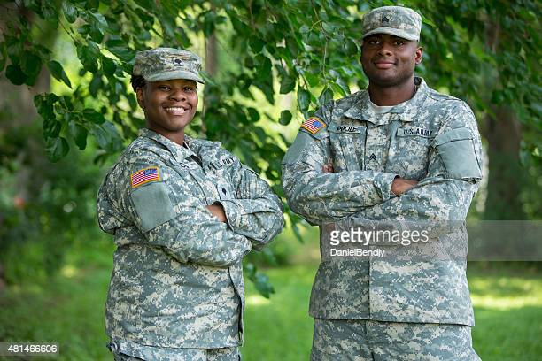 dual militay couple - military uniform stock pictures, royalty-free photos & images